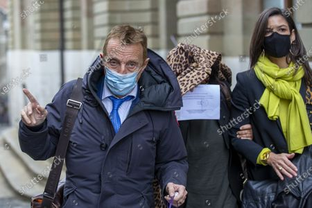 Stock Photo of Brigitte (face behind her coat), one of the alleged victim of Swiss leading Islamic scholar Tariq Ramadan leaves Geneva's courthouse with his Swiss lawyer Robert Assael (L) after a first hearing with Geneva's prosecutor as part of an investigation over sexual assault, in Geneva, Switzerland, 10 November 2020. It is the first time the Islamologist leaves France since he was indicted in Paris on February 2018. His judicial supervision, which prohibited him from travelling outside France, was amended last month to allow him to take part in the hearing in Geneva.