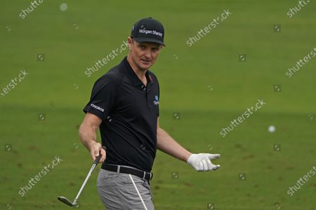 Justin Rose, of England, waits to hit at the driving range during a practice round for the Masters golf tournament, in Augusta, Ga
