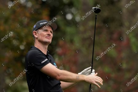 Justin Rose, of England, watches his tee shot on the fourth hole during a practice round for the Masters golf tournament, in Augusta, Ga