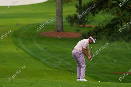 Ian Poulter, of England, hits on the seventh fairway during a practice round for the Masters golf tournament, in Augusta, Ga