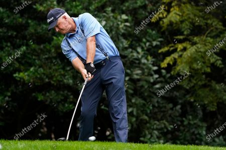 Stock Picture of Sandy Lyle, of Scotland, tees off on the 11th hole during a practice round for the Masters golf tournament, in Augusta, Ga