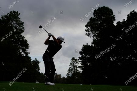 Graeme McDowell, of Northern Ireland, tees off on the ninth hole during a practice round for the Masters golf tournament, in Augusta, Ga