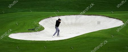 Justin Rose of England hits out of a bunker on the fourth hole during the second practice round of the 2020 Masters Tournament at the Augusta National Golf Club in Augusta, Georgia, USA, 10 November 2020. After being delayed seven months by the coronavirus pandemic, the 2020 Masters Tournament is being held without patrons 12 November through 15 November.