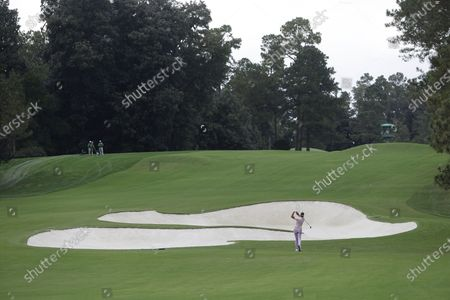 Ian Poulter of England hits out of a fairway bunker on the eighth hole during the second practice round of the 2020 Masters Tournament at the Augusta National Golf Club in Augusta, Georgia, USA, 10 November 2020. After being delayed seven months by the coronavirus pandemic, the 2020 Masters Tournament is being held without patrons 12 November through 15 November.