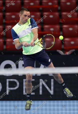 Stock Photo of Serbia's Viktor Troicki in action against Australia's Jurgen Melzer and France's Edouard Roger-Vasselin during the ATP 250 Sofia Open doubles qualifications.