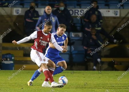 William Saliba of Arsenal passes the ball upfield as Manager, Steve Bould looks on during Gillingham vs Arsenal Under-21, Papa John's Trophy Football at the MEMS Priestfield Stadium on 10th November 2020