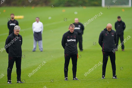 West Ham United coaches Stuart Pearce, Alan Irvine and Paul Nevin stand together for minute?s silence to commemorate Remembrance Day