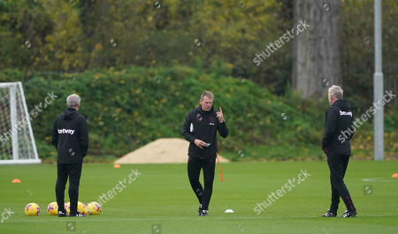 West Ham United coaches Alan Irvine and Stuart Pearce with manager David Moyes during the training session