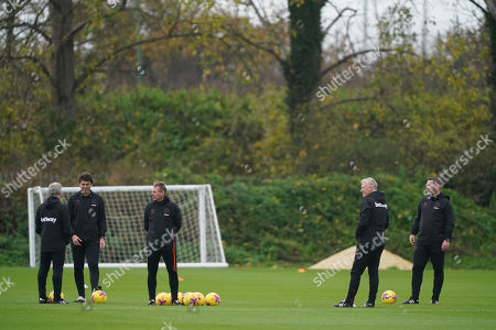 West Ham United coaches Alan Irvine, Xavi Valero, Stuart Pearce, Kevin Nolan with manager David Moyes during the training session