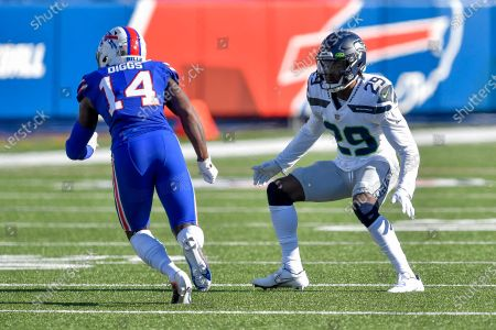 Seattle Seahawks cornerback D.J. Reed (29) defends against Buffalo Bills wide receiver Stefon Diggs (14) during the first half of an NFL football game, in Orchard Park, N.Y