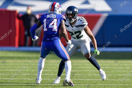 Seattle Seahawks cornerback Quinton Dunbar (22) covers Buffalo Bills wide receiver Stefon Diggs (14) during the first half of an NFL football game, in Orchard Park, N.Y
