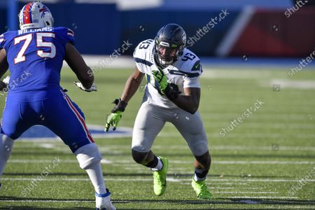 Seattle Seahawks linebacker Carlos Dunlap II (43) rushes against the Buffalo Bills during the first half of an NFL football game, in Orchard Park, N.Y