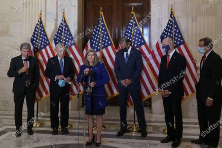 Speaking to reporters after the GOP leadership elections are, from left, Policy Committee Chairman Roy Blunt, R-Mo., Senate Majority Leader Mitch McConnell, R-Ky., Conference Vice Chairman Joni Ernst, R-Iowa, Majority Whip John Thune, R-S.D., National Republican Senatorial Committee Rick Scott, R-Fla., and Conference Chairman John Barrasso, R-Wyo., on Capitol Hill in Washington