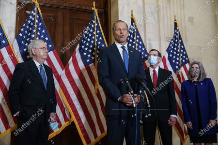 Stock Image of Speaking to reporters after the GOP leadership elections are, from left, Senate Majority Leader Mitch McConnell, R-Ky., Majority Whip John Thune, R-S.D., Conference Chairman John Barrasso, R-Wyo., and Conference Vice Chairman Joni Ernst, R-Iowa, on Capitol Hill in Washington