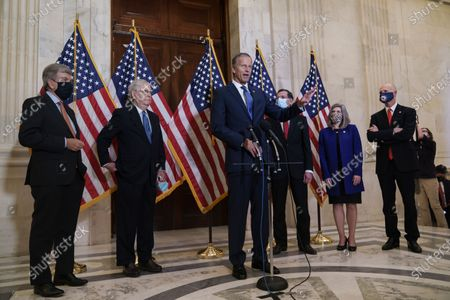 Speaking to reporters after the GOP leadership elections are, from left, Policy Committee Chairman Roy Blunt, R-Mo., Senate Majority Leader Mitch McConnell, R-Ky., Majority Whip John Thune, R-S.D., Conference Chairman John Barrasso, R-Wyo., Conference Vice Chairman Joni Ernst, R-Iowa, and National Republican Senatorial Committee Rick Scott, R-Fla., on Capitol Hill in Washington