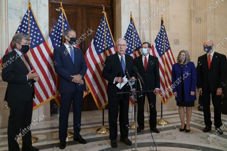 Senate Majority Leader Mitch McConnell, R-Ky., speaks to reporters following a closed-door meeting where the Republican Conference held leadership elections, on Capitol Hill in Washington, . McConnell won another term as the GOP leader, cementing his role as the longest-serving Republican leader in U.S. history. He is joined by, from left, Policy Committee Chairman Roy Blunt, R-Mo., Majority Whip John Thune, R-S.D., Conference Chairman John Barrasso, R-Wyo., Conference Vice Chairman Joni Ernst, R-Iowa, and National Republican Senatorial Committee Rick Scott, R-Fla
