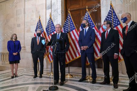 Senate Majority Leader Mitch McConnell, R-Ky., talks briefly to reporters after the Republican Conference held leadership elections, on Capitol Hill in Washington, . He is joined by, from left, Conference Vice Chairman Joni Ernst, R-Iowa, Policy Committee Chairman Roy Blunt, R-Mo., Majority Whip John Thune, R-S.D., Conference Chairman John Barrasso, R-Wyo., and National Republican Senatorial Committee Rick Scott, R-Fla