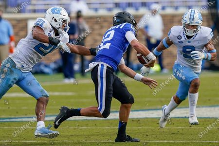 Stock Photo of Duke Blue Devils quarterback Gunnar Holmberg (12) is pressured by North Carolina Tar Heels linebacker Chazz Surratt (21) and defensive back Cam'Ron Kelly (9) during the second half at Wallace Wade Stadium, Saturday, Nov. 7, 2020, in Durham, N.C
