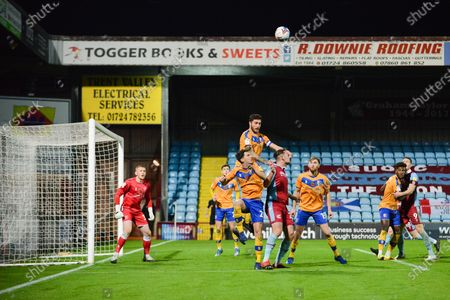 Stock Photo of Ryan Sweeney (5) of Mansfield Town heads the ball during the EFL Trophy match between Scunthorpe United and Mansfield Town at the Sands Venue Stadium, Scunthorpe
