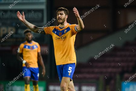 Stock Picture of Ryan Sweeney (5) of Mansfield Town pointing, directing, signalling, gesture during the EFL Trophy match between Scunthorpe United and Mansfield Town at the Sands Venue Stadium, Scunthorpe