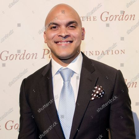 Grammy award winning trumpet player Irvin Mayfield arrives at The Gordon Parks Foundation Awards Dinner and Auction at Cipriani's Wall Street in New York. Mayfield and his musical partner, pianist Ronald Markham, each pleaded guilty, to a conspiracy to commit fraud charge. The federal charge stemmed from the time the two spent as board members of the charitable New Orleans Public Library Foundation. Prosecutors alleged that they steered more than $1.3 million raised for public libraries to themselves by funneling it through the New Orleans Jazz Orchestra, which Mayfield founded