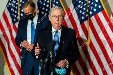 Stock Picture of Senate Majority Leader Mitch McConnell of Ky., with Sen. John Thune, R-S.D., speaks to reporters following a Republican policy luncheon attended by Vice President Mike Pence on Capitol Hill, in Washington