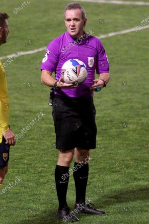 REFEREE CARL BROOK during the EFL Trophy match between Walsall and Oxford United at the Banks's Stadium, Walsall