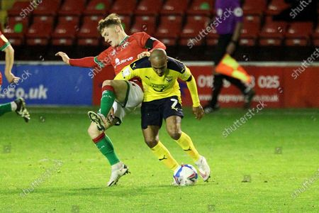 Walsall's Alfie Bates Oxford United's Rob Hall during the EFL Trophy match between Walsall and Oxford United at the Banks's Stadium, Walsall