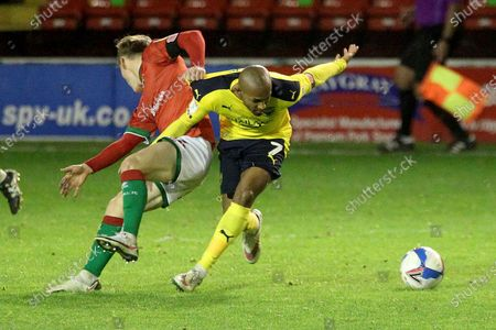 Oxford United's Rob Hall Walsall's Alfie Bates during the EFL Trophy match between Walsall and Oxford United at the Banks's Stadium, Walsall