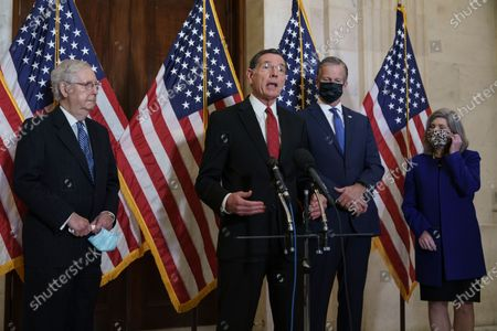 Following leadership elections in the Senate Republican Conference, Conference Chairman John Barrasso, R-Wyo., center, speaks to reporters on Capitol Hill in Washington, . He is joined by, from left, Senate Majority Leader Mitch McConnell, R-Ky., Majority Whip John Thune, R-S.D., and Conference Vice Chairman Joni Ernst, R-Iowa