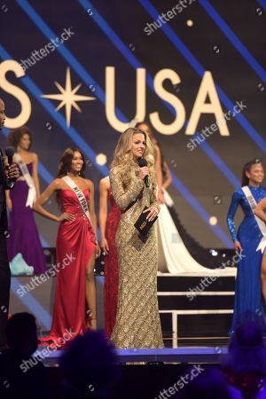 Stock Photo of Allie LaForce, Co-Host, 2020 Miss USA Host, 2020 Miss Teen USA on stage in a Sherri Hill gown, an official sponsor of the 2020 Miss USA competition, during the Top 5 question round and final walk, at the Miss USA Competition, on November 7, 2020 at Graceland in Memphis Tennessee.