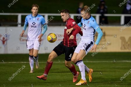 Stock Image of Andy McDonald (4) of Elgin and Coll Donaldson (25) of Ross County