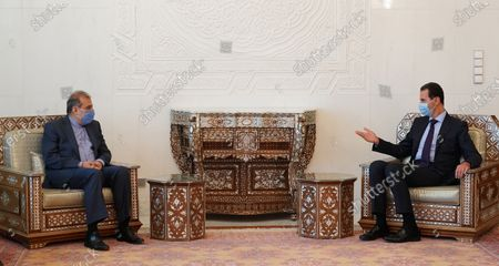 A handout photo released by Sana shows Syrian President Bashar al-Assad (R) meeting with Ali Asghar Khaji, (L) senior assistant to the Iranian Foreign Minister, and an accompanying delegation in Damascus, Syria, 10 November 2020.