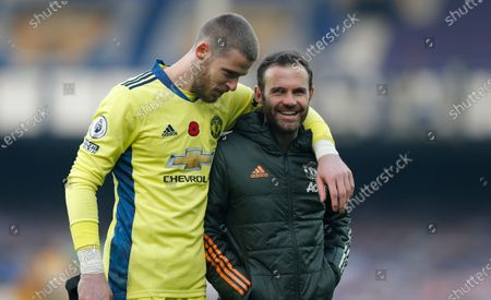 Stock Image of Juan Mata of Manchester United and Manchester United goalkeeper David De Gea leave the pitch at the end of the match