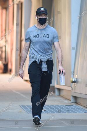Hugh Jackman takes a walk
