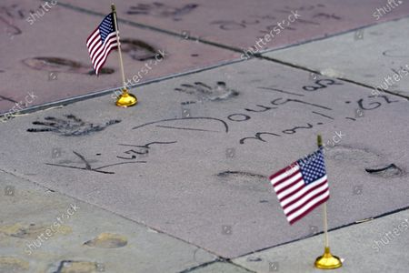 An American flag is placed on the hand and footprints of the late actor Kirk Douglas at the TCL Chinese Theatre forecourt, in Los Angeles. Flags were placed on the hand and footprints of Hollywood stars who served in their country's military