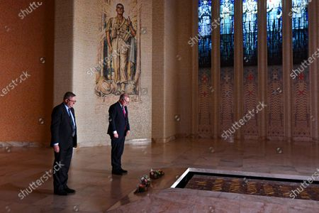 Australian Prime Minister Scott Morrison (R) and Australian Opposition Leader Anthony Albanese (L) lay flowers at the tomb of the unknown soldier during the 2020 Remembrance Day ceremony at the Australian War Memorial in Canberra, Australia, 11 November 2020.