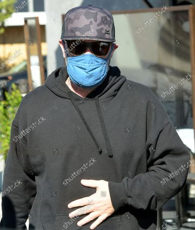 Fred Durst wears a face mask as he is seen out in West Hollywood