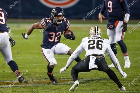 Chicago Bears running back David Montgomery (32) is defended by New Orleans Saints cornerback P.J. Williams (26) during the second half of an NFL football game, in Chicago