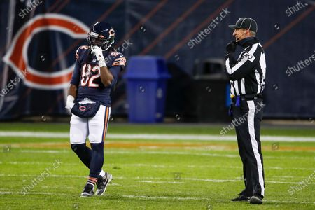 Back Judge Todd Prukop, right, jokes with Chicago Bears wide receiver Dwayne Harris (82) during the second half of an NFL football game against the New Orleans Saints, in Chicago