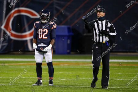 Back Judge Todd Prukop, right, signals next to Chicago Bears wide receiver Dwayne Harris (82) during the second half of an NFL football game against the New Orleans Saints, in Chicago