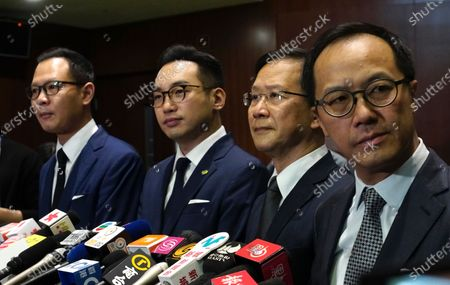 Four lawmakers, from left, Dennis Kwok, Alvin Yeung, Kenneth Leung, Kwok Ka-ki and Kenneth Leung listen to reporters questions during a press conference at Legislative Council in Hong Kong, . Hong Kong has moved to disqualify the four pro-democracy legislators after Beijing passed a resolution that would allow the local government to remove lawmakers from their positions if they're deemed to threaten national security