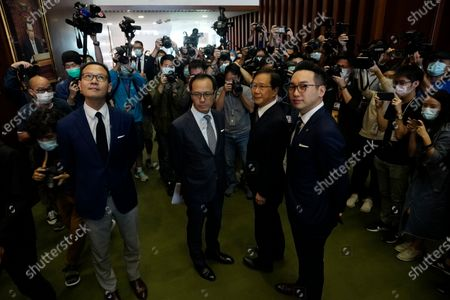 Stock Photo of Four lawmakers, from left, Dennis Kwok, Kenneth Leung, Kwok Ka-ki and Alvin Yeung pose after a news conference at Legislative Council in Hong Kong, . Hong Kong has moved to disqualify the four pro-democracy legislators, after Beijing passed a resolution that would allow the local government to remove lawmakers from their positions if they're deemed to threaten national security