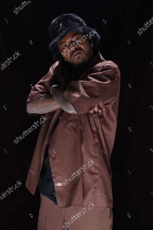 Trick Daddy poses for a portrait during a photo session in the studio