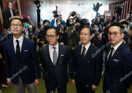 Four lawmakers, from left, Dennis Kwok, Kenneth Leung, Kwok Ka-ki and Alvin Yeung pose after a news conference at Legislative Council in Hong Kong, . Hong Kong has moved to disqualify the four pro-democracy legislators, after Beijing passed a resolution that would allow the local government to remove lawmakers from their positions if they're deemed to threaten national security