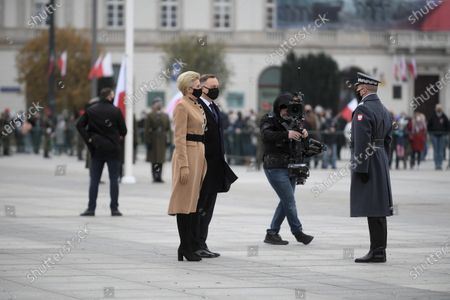 Stock Photo of Polish President Andrzej Duda (C) and his wife Agata Kornhauser-Duda (L) during the celebration of Independence Day at Marshal Jozef Pilsudski Square in Warsaw, Poland 11 November, 2020.