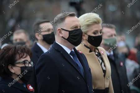 Stock Image of Polish President Andrzej Duda (C) and his wife Agata Kornhauser-Duda (R) and Marshal of the Sejm of the Republic of Poland Elzbieta Witek (L) during the celebration of Independence Day at Marshal Jozef Pilsudski Square in Warsaw, Poland 11 November, 2020.