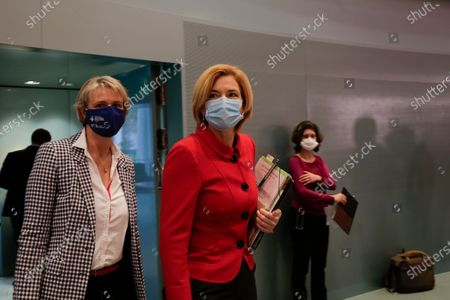 German Science and Education Minister Anja Karliczek left, and German Agriculture Minister, Julia Kloeckner arrive to the weekly cabinet meeting of the German government at the chancellery in Berlin, Germany