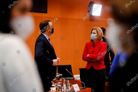 German Health Minister Jens Spahn, left, talks with German Agriculture Minister, Julia Kloeckner, right, prior to the weekly cabinet meeting of the German government at the chancellery in Berlin, Germany