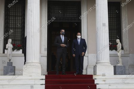 Greece's Prime Minister Kyriakos Mitsotakis, left, welcomes the Egyptian President Abdel-Fattah el-Sissi before their meeting at Maximos Mansion in Athens, . Egypt's president is meeting with Greek officials in Athens, on his first visit to the southern European nation since the two countries signed a deal demarcating maritime boundaries between them in the eastern Mediterranean